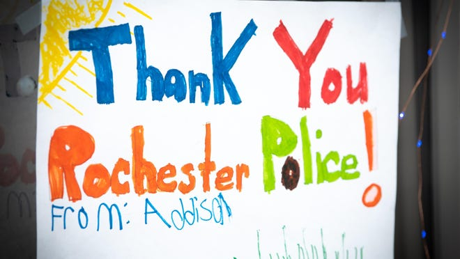 A show of support from a young artist during an earlier Paint the City Blue event