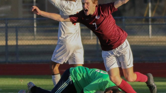 Salina Central's Logan Johnson (7) celebrates after giving the Mustangs a 2-0 lead over Great Bend on Thursday at Salina Stadium. Great Bend came back to score three times in the second half and win the Class 5A Region 1 final, 3-2.