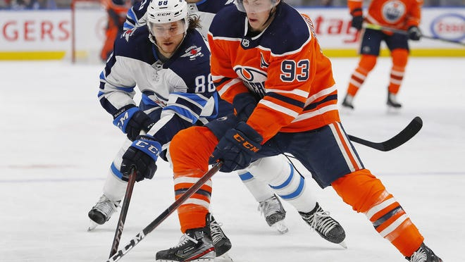Oilers center Ryan Nugent-Hopkins, right, is one possible trade target for the Blue Jackets.