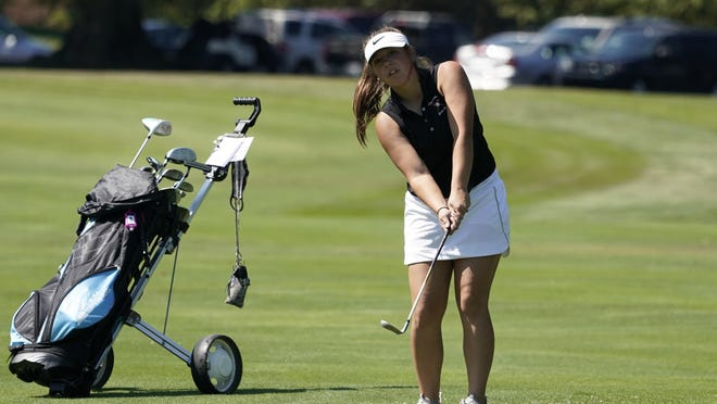 Tecumseh's Ella Corson watches her shot during the Tecumseh Invitational at Tecumseh Country Club Friday to kick off the 2020 season.