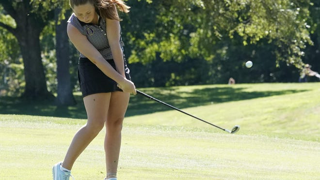 Onsted's Jaime Metzger hits her ball off the fairway during Monday's IGL Jamboree at the Hills of Lenawee Golf Club in Adrian. Metzger won the overall medalist honors, carding a 40 for the Wildcats. Telegram photo by Mike Dickie lenconnect_com