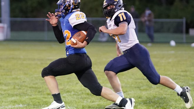 Madison's Dante Cerasuolo runs with the ball while Whiteford's Levi Hillard gives chase during Friday's game.