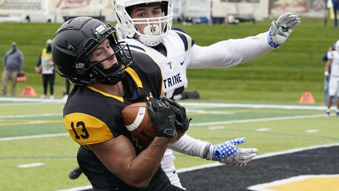 Adrian College receiver Gage Palus hauls in a touchdown during Saturday's game against Trine.