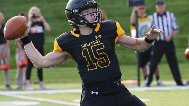 Adrian College quarterback Jack Wurzer sets to throw during a game in the 2019 season.