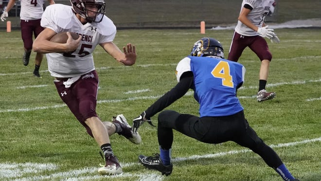Morenci's Cam Smith runs with the ball during Friday's game at Madison.