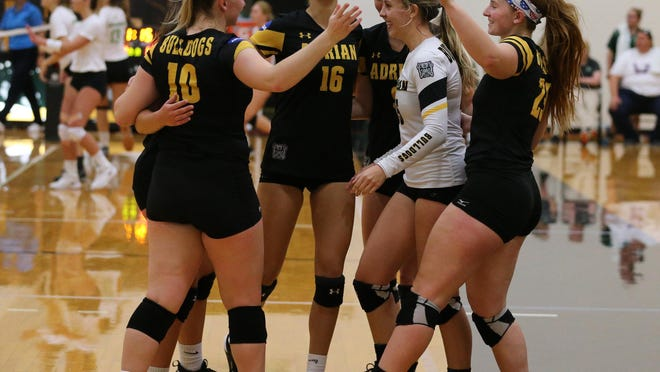 The Adrian College women's volleyball team celebrates winning a point during a match against Albion on Aug. 31, 2019.