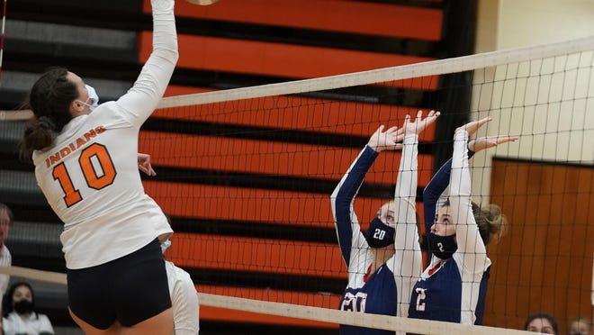 Tecumseh's Jaden Benschoter goes up for a kill while Britton Deerfield's Camryn Fore (20) and Katelyn Beard (2) go for a block during Thursday's quad.