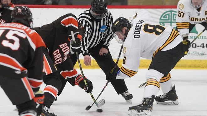 Adrian College junior Zach Goberis (8) takes a faceoff during Saturday's nonconference game against NCAA Division III Bowling Green State University at Arrington Ice Arena.