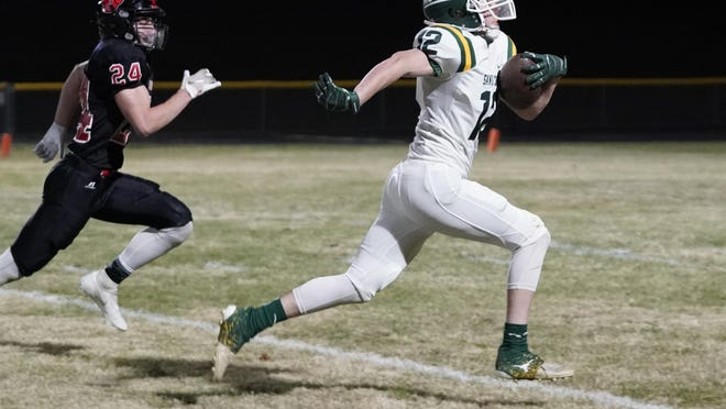 Sand Creek's Will Alexander carries the ball during the Division 8 district final game at Addison.