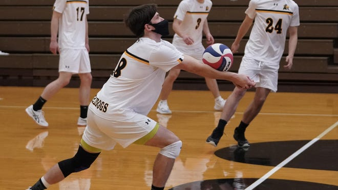 Adrian College's Chase Heuer (48) digs out a ball during a match of Sunday's MCVL doubleheader against Trine University at the Merillat Sport and Fitness Center.