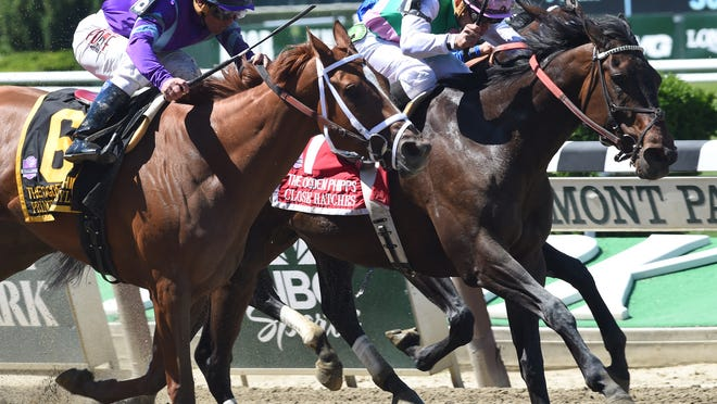 Horses race down the stretch at the Ogden Phipps Stakes in this file photo from 2014.