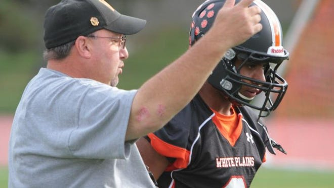 Skip Stevens, pictured with former quarterback Cameron Crabbe in 2013, resigned after 11 seasons as the White Plains football coach.