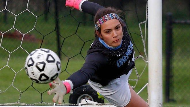 Okemos senior goalie Caroline Serkaian signed to play at Division I University of Wisconsin-Milwaukee earlier this year.
