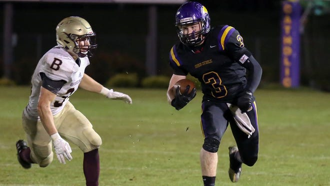 Guerin Catholic's Carter McGinnis (right) was named to the All-Circle City Conference team.