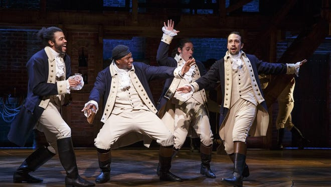 Undated handout photo shows Daveed Diggs, Okieriete Onaodowan, Anthony Ramos, and Lin-Manuel Miranda in a scene from the Broadway musical Hamilton at Broadway's Richard Rodgers Theatre.