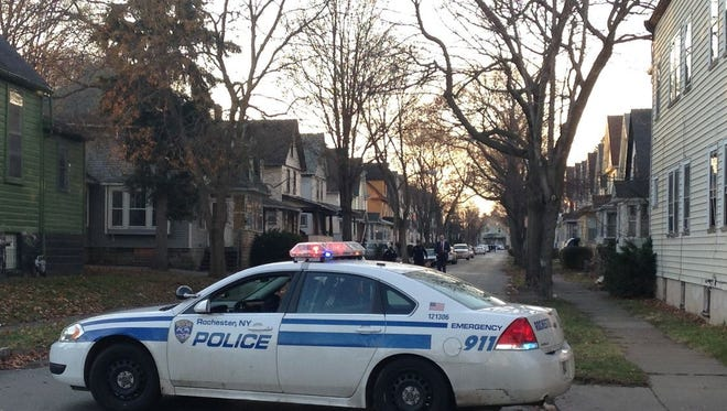 A police car blocks entry to Herald Street from Carter Street on Dec. 27, 2014. Police responded to a call regarding a wounded man in this area. The man, Eric Caster, died in a hospital two days later.
