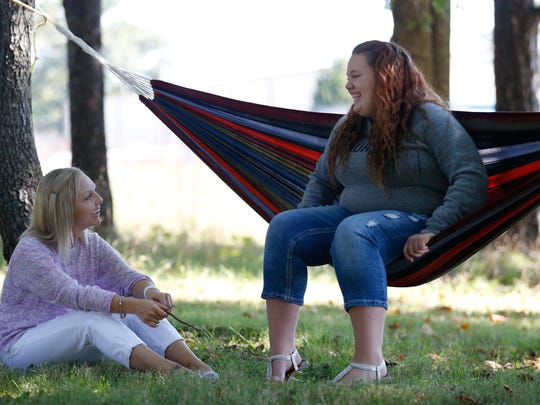 Shannon Tatum (left), a life coach with I Pour Life, talks with Ashley Joy, 19, during a positive affirmation session at I Pour Life on Thursday, Sept. 22, 2016. I Pour Life is a program that helps at risk youth transition into adulthood.