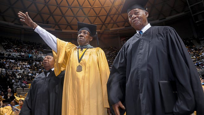 St. John Dixon (far left), James McFadden and Joseph Peterson, students expelled for participating in a 1960 sit-in in Montgomery, wave after receiving honorary degrees during commencement exercises at Alabama State University May 8, 2010.