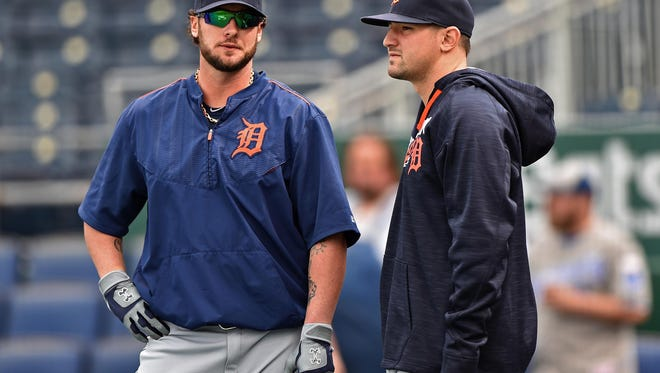 Tigers catcher Jarrod Saltalamacchia (left) and third basemen Nick Castellanos look on during batting practice before Thursday's loss in Kansas City, Mo.