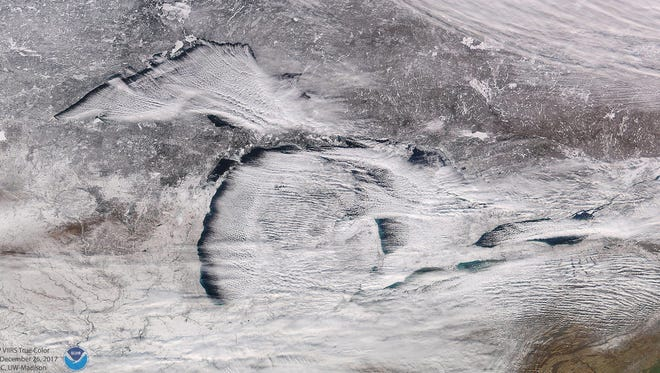 The National Oceanic and Atmospheric Administration Satellites Twitter account released this image of lake-effect snow and its impact across Michigan, the Great Lakes and the Eastern United States and Canada on Wednesday, Dec. 27, 2017. The satellite image was taken Tuesday, Dec. 26, 2017.