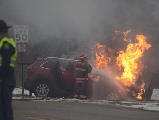 Emmett Township firefighters battle a car fire after