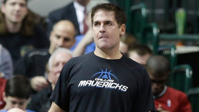 Dallas Mavericks owner Mark Cuban watches his team play during the first half of an NBA basketball game against the Miami Heat Feb. 18, 2014, in Dallas.