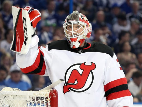 Apr 21, 2018; Tampa, FL, USA; New Jersey Devils goaltender Cory Schneider (35) reacts against the Tampa Bay Lightning during the first period of game five of the first round of the 2018 Stanley Cup Playoffs at Amalie Arena.