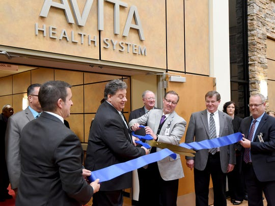 Avita Health System in Ontario had its ribbon-cutting ceremony Thursday afternoon. Jerome Morasko and Doug Schilling handled the scissors.