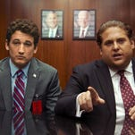 """This image released by Warner Bros. Pictures shows Miles Teller, left, and Jonah Hill in a scene from, """"War Dogs."""""""