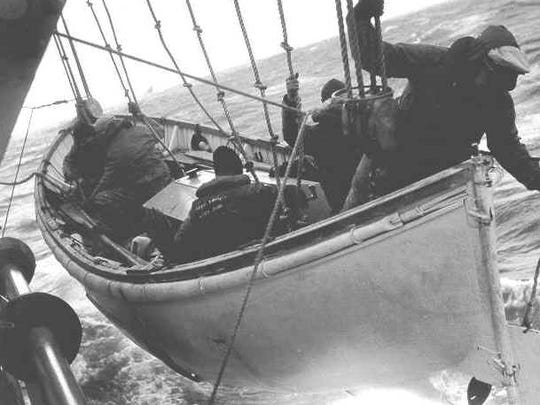 Despite extremely heavy seas, the Yakutat lowers William Kiely's surfboat to remove two survivors from the bow of the S.S. Fort Mercer.