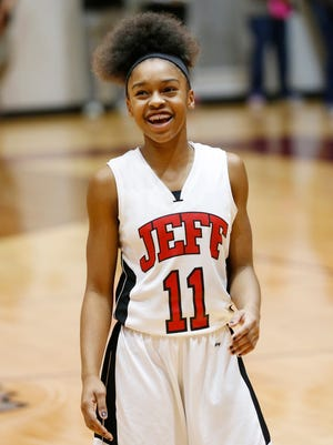 Lafayette Jeff's Brandi Norton is all smiles as the final seconds tick away in the Bronchos 37-30 victory over Logansport in the first round of the Girls Basketball Sectional Tuesday, February 2, 2016, at McCutcheon High School.