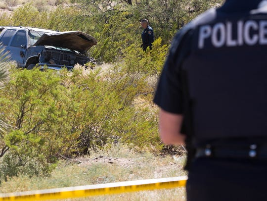 Las Cruces Police officers investigating the scene