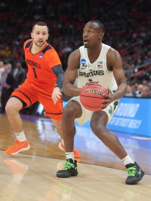 Michigan State guard Joshua Langford drives against Bucknell guard Kimbal Mackenzie during the first half of the first round of the NCAA tournament game on Friday, March 16, 2018, at Little Caesars Arena.