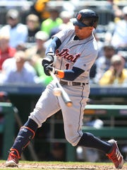 Tigers center fielder Leonys Martin (12) singles during the Tigers' 1-0 loss on Thursday, April 26, 2018, in Pittsburgh.