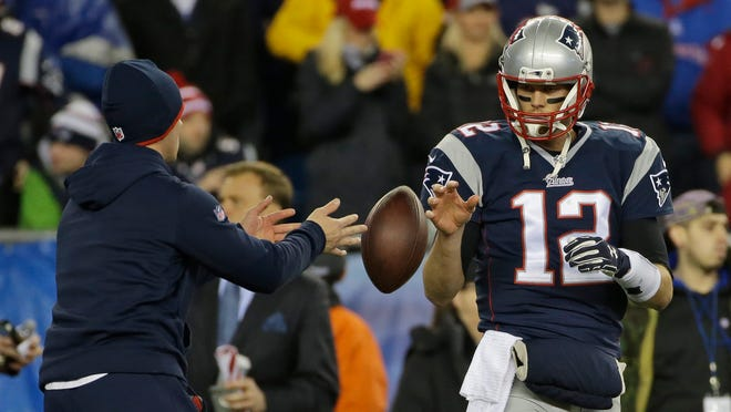 A ball boy tosses ball to Tom Brady during warmups. Was this ball illegal?