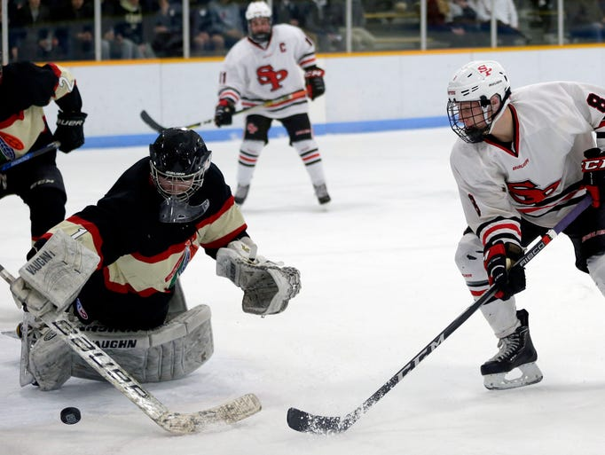 SPASH player Trey Zagrzebski scores on Pacelli goaltender