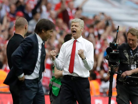 Arsenal team manager Arsene Wenger, right, celebrates his team's victory next to Chelsea team manager Antonio Conte, left, during the English FA Cup final soccer match between Arsenal and Chelsea at the Wembley stadium in London, Saturday, May 27, 2017. (AP Photo/Matt Dunham)