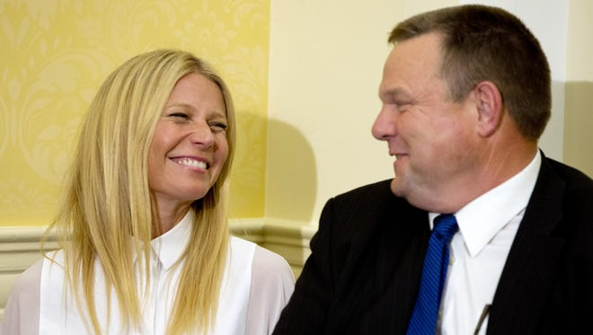 Actress Gwyneth Paltrow, talks with Sen. Jon Tester, D-Mont., during a news conference on GMO labeling in Washington.