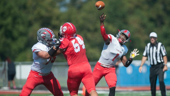 Vineland's Isaih Pacheco releases a pass during the 1st quarter of Saturday's football game between Vineland and Cherry Hill East, played at Cherry Hill East High School.  Vineland won 61-6.