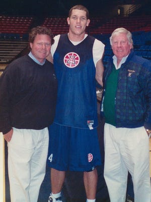 Luke Walton, center, stands with Lou Gerber, right, and his son, Tim Gerber, at the University of Arizona in the early 2000s.