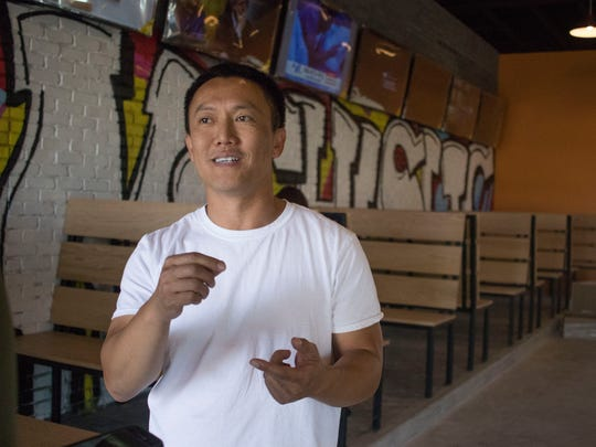 Co-owner Hong Phrommany lists off different menu options