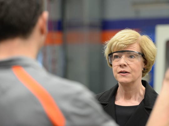 Sen. Tammy Baldwin talks about manufacturing technology during a tour of the Bay Link Manufacturing lab at West High School.