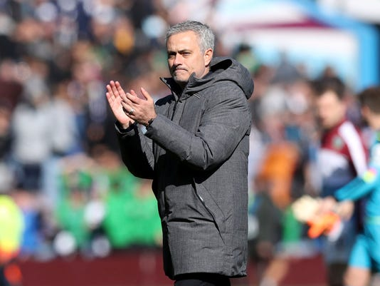 Manchester United manager Jose Mourinho applauds the fans after the English Premier League soccer match against  Burnley at Turf Moor, Burnley, England, Sunday April 23, 2017. (Martin Rickett/PA via AP)