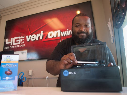 Manager, Raymond Stansbury from the Verizon Premium Wireless Retailer in Clementon shows new technology that restores hope when electronics take a plunge. The new device, Redux, dries and restores your phone.