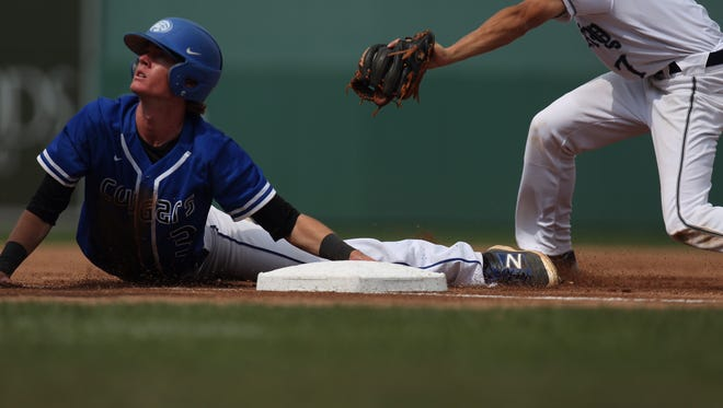 Carter Smith of Canterbury slides safely into third base during a semifinal game against Maclay.   He later scored