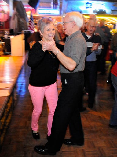 Sharon Gall, Elk River, dances with Marc Tadych, Sartell, to the music of the Waltzeteers at Rollie's Rednecks & Longnecks in Sauk Rapids.