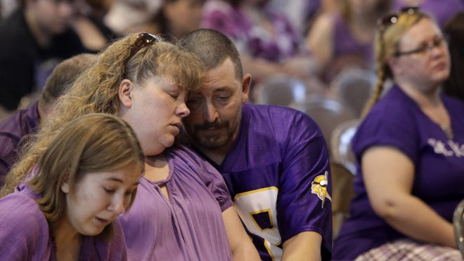 Parents Denise Shepard with husband Mike are shown during the memorial service for Kathlynn Shepard in June at Webster-Grand Middle School gymnasium in Boxholm.