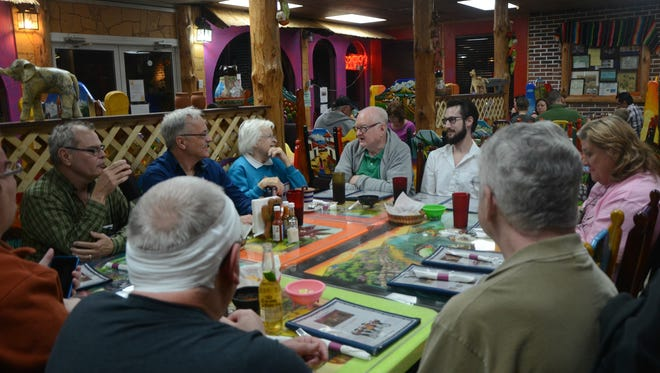 Members of Battle Creek Pride attend a Dining OUT event Tuesday at Nina's Taqueria on Capital Avenue Southwest.