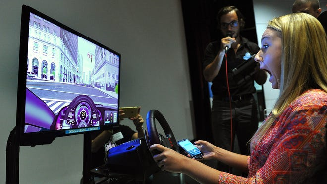 "In 2014, Vanessa Capps, 17, then a senior at South Fork High School, discovers she's about to run a red traffic light at 25 miles per hour while texting in a driving simulator during the AT&T ""It Can Wait"" program at South Fork High School on Monday, Oct. 20, 2014. In the Sunshine State, distracted driving crashes increased 26 percent from 2013 to 2016, according to the Florida Department of Highway Safety and Motor Vehicles. There were almost 50,000 crashes involving distracted driving in Florida in 2016, resulting in 3,500 bodily injuries and 233 fatalities."
