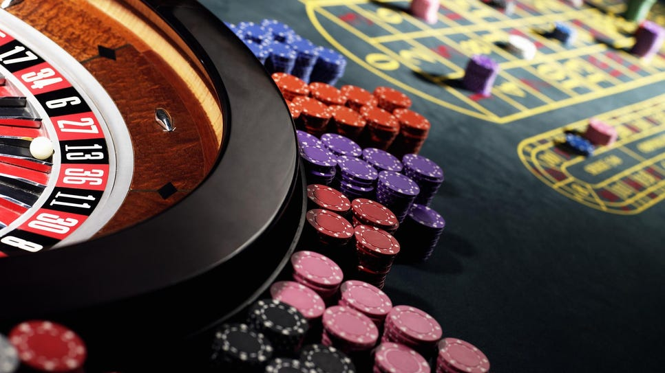 File art of gambling chips around a roulette wheel.